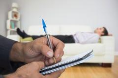 Złożony wizerunek zakończenie up mężczyzna writing w spirali książce Zdjęcia Stock