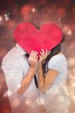 Złożony wizerunek zakrywa ich buziaka z sercem para Zdjęcia Stock