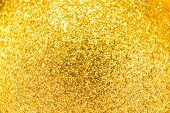 Złociści błyskotliwi bożonarodzeniowe światła zamazujący abstrakcyjne tło Obraz Stock