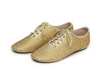 Złoci błyskotliwość buty odizolowywający na bielu zdjęcie stock