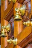 Złoci dzwony na drewnianym drzwi fotografia royalty free