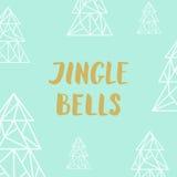Złoci literowania dźwięczenia dzwony i trójboków jedlinowi drzewa na turquois Zdjęcia Stock