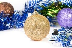 Złoci ornamenty na świecidełko dekoraci Zdjęcie Stock