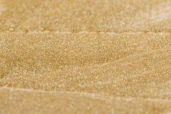 Złocista błyszcząca tekstura, żółci cekiny z plamy tłem Zdjęcia Stock