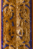 Złocista Buddha statua na ścianie w kościół przy buddyjską świątynią w T Zdjęcia Stock