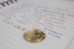 Złocista peercoin moneta zdjęcie stock