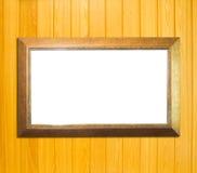 Złocista rocznika obrazka rama na drewnianym tle fotografia stock