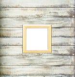 Złocista Rocznika obrazka rama na starym drewnianym tle Obrazy Stock