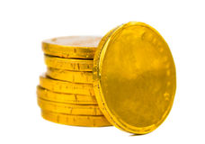 Złociste monety odizolowywać Zdjęcia Stock