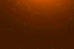 Złocistego pyłu cząsteczki płynie tło zapętlają bezszwowego przygotowywającego, złotego lekkiego punkt, Fotografia Royalty Free