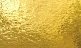 Złocistej folii tekstury tło Fotografia Stock