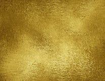 Złocistej folii tekstury tło Grunge złoty kruszcowy materiał co Zdjęcia Stock