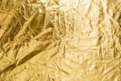 Złocistej folii tekstury tło w naturalnym świetle zdjęcia stock