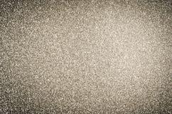 Złocisty błyskotliwości tekstury tło z winietą Zdjęcia Stock