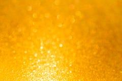 Złocisty bokeh błyskotliwości światła tekstury abstrakta tło Zdjęcie Royalty Free