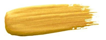 Złocisty kolor farby muśnięcia uderzenie Akrylowa złota rozmaz plama na białym tle Abstrakcjonistyczny szczegółowy złocisty połys Obrazy Stock
