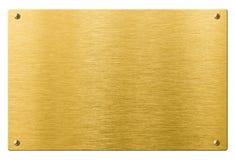 Złocisty lub mosiężny metalu talerz z nitami odizolowywającymi Obraz Stock