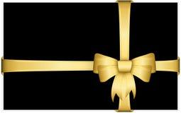Złocisty prezenta łęk z faborkami Zdjęcia Royalty Free