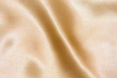 Złocisty tekstylny tło Zdjęcia Stock