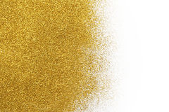 Złota błyskotliwość piaska tekstura na białym, abstrakcjonistycznym tle, obrazy royalty free