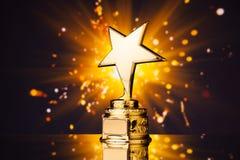 Złota gwiazdowy trofeum obraz royalty free