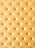 Złota kolor kanapy płótna tekstura Obrazy Stock