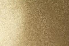 Złota lub brązu Naturalny Rzemienny tło Błyszczący żółty liść złocistej folii tekstury tło miejsce tekst obraz royalty free