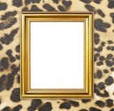 Złota rama z lampart tekstury tłem zdjęcie stock