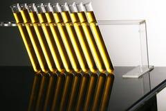 Złota tubka z rzędu obrazy stock