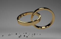 Złote obrączki ślubne z diamentem Zdjęcie Royalty Free