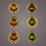 Złote osłony z laurowym wiankiem Zdjęcia Royalty Free