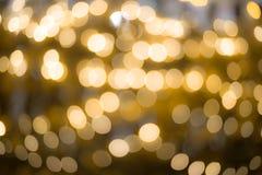 Złotego bokeh zamazany abstrakcjonistyczny tło Zdjęcia Royalty Free