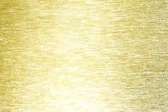 Złotego metalu mosiądza tła porysowana tekstura Zdjęcia Royalty Free