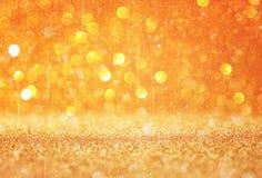 Złoto i ciepli abstrakcjonistyczni bokeh światła defocused background/ Obraz Stock