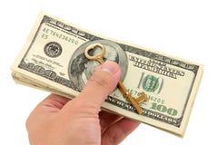 złoto klucza dolarów fotografia stock