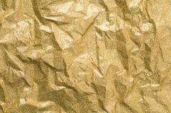 Złoto marszczący papierowy tekstura abstrakta tło Obrazy Royalty Free
