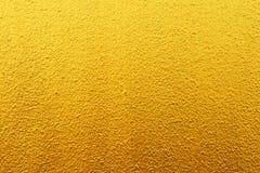 Złoto textured ściana dla tła Zdjęcie Stock