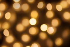 Złoty światła bokeh zamazywał tło, abstrakcjonistyczna piękna rozmyta srebna Bożenarodzeniowa wakacyjnego przyjęcia tekstura, kop Zdjęcia Royalty Free