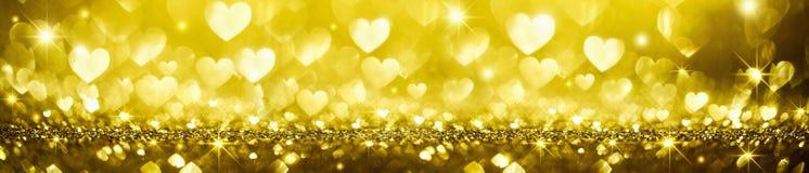 Złoty Błyszczący tło z sercami Zdjęcia Stock