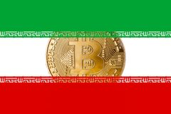 Złoty bitcoin wśrodku Irańskiego flaga, Iran cryptocurrecy concep/ zdjęcie royalty free