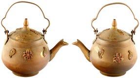 Złoty czajnik z małymi dekoracjami Zdjęcie Royalty Free
