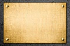 Złoty metalu talerz, signboard na ścianie lub Obraz Stock