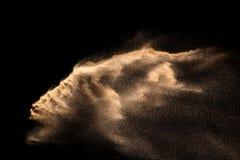 Złoty piaska wybuch odizolowywający na czarnym tle Abstrakcjonistyczna piasek chmura Obrazy Stock