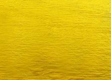 Złoty tło, szorstka złota tekstura zdjęcia stock