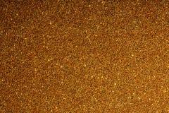 Złoty tło z błyska teksturę wielki postanowienie Zdjęcie Stock