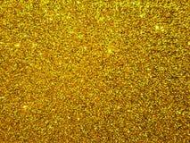Złoty textured tło z błyskotliwość skutka tłem fotografia stock
