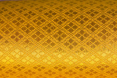 Złoty tkanina wzoru tło. Zdjęcie Royalty Free