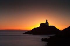 Złoty wschód słońca nad bełkot latarnią morską Obrazy Royalty Free