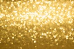 Złoty zamazany tło zdjęcia stock