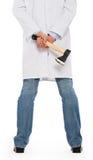 Zły student medycyny trzyma małą cioskę Fotografia Stock